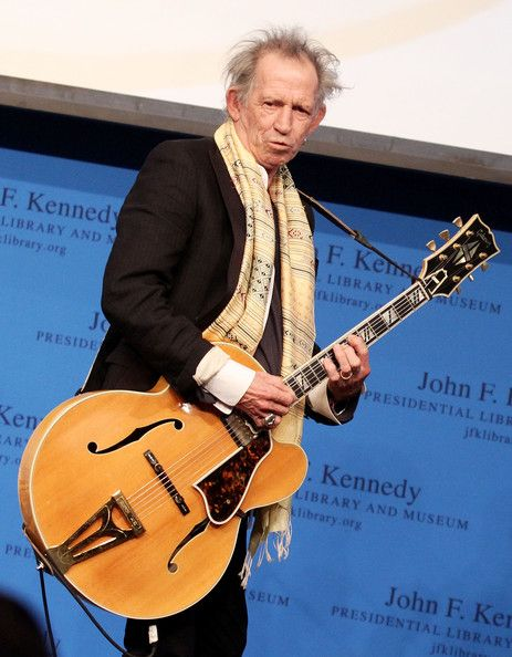 Keith Richards with another Gibson hollow-body, this time ...