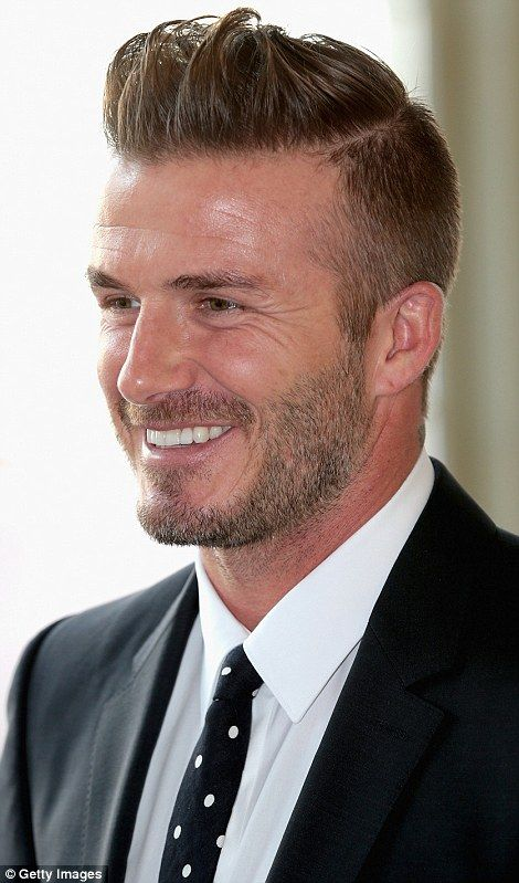 Looking good: Typically on-trend, the 40 year-old wore a dark, navy blue suit which he mat...