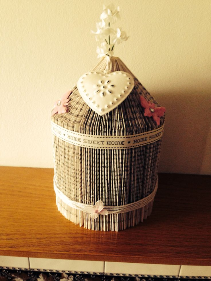 Handmade bird cage made from an old book and decorated ...