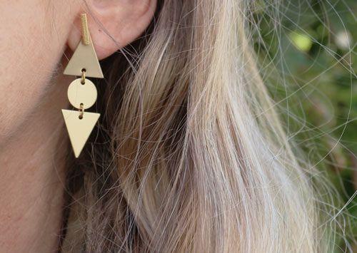 Ørering med stav og trekanter