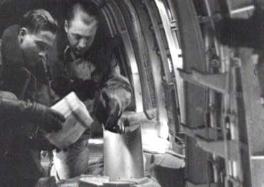 WWII-RAF crew drop budles of propaganda Leaflets over Germany.