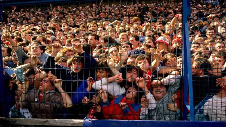 People being crushed against a fence during a human crush at Hillsborough Stadium, 1989 — Many uninjured fans assisted the injured; several attempted CPR and others tore down advertising hoardings to use as stretchers.