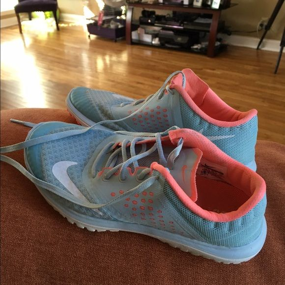 Super cute Nikes These super cute Nikes are Tiffany blue and light coral colored. Excellent used condition. Nike Shoes Athletic Shoes