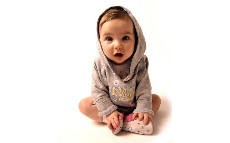 Lovely cute baby boy wearing a light brown jumper wallpaper
