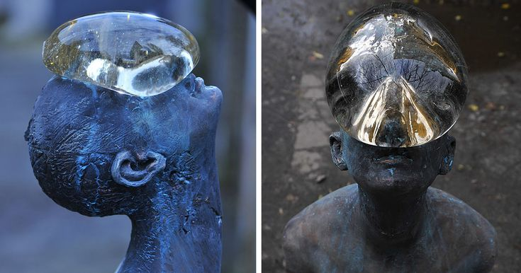 Sculpture Of Giant Raindrop Resting On Man's Face In Ukraine. The 6-foot tall bronze and glass statue is called Rain and it's the creation of Ukrainian artist Nazar Bilyk.