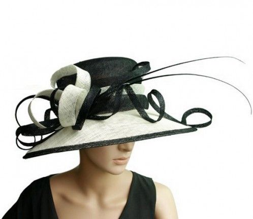 """""""Vogue"""" Large Black and White Wide Rimmed Fascinator HatStyle poise and femininity is captured beautifully in this stunning hand-made piece. Our 'Vogue' hat offer a wide brim with black edge, black and white bands around the crown and a gorgeous arrangement of black and white sinamay curls and finished with black batons. $119.95 including gift box and FREE shipping in Australia."""