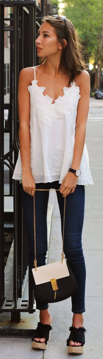 Just The Design: Felicia Akerstrom is wearing a H&M top with Topshop jeans and wedges from NLY