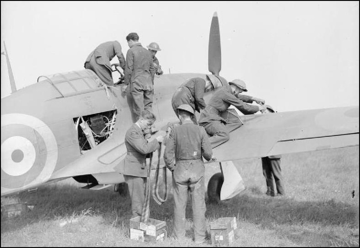"A Hawker Hurricane Mk I flown by Fl/lt J. E. ""Ian"" SCOULAR commander of ""B"" Flight 73 Squadron RAF, being refuelled and re-armed between sorties - Reims airfield (France) May 1940."