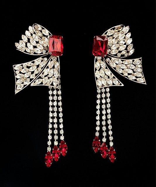 Yves Saint Laurent. 1983. When worn together, the pair creates a whole bowknot and frames the wearer's face with glittering stones some of which swing with every turn of her head.