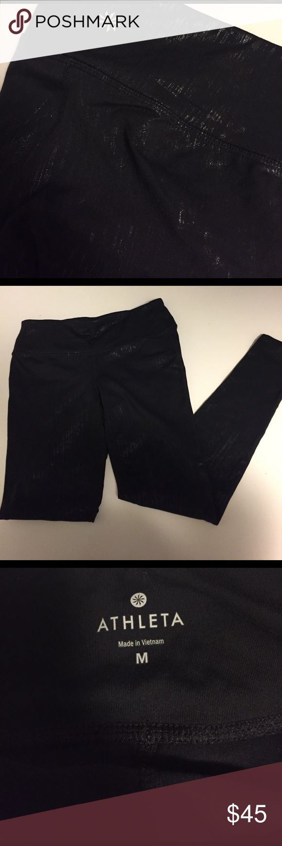 Like new Athleta spandex pants black w/gold detail Worn only a few times, black with gold detail, can be worn workout or casual! size medium, extremely light pilling in upper thigh area. Worn maybe 3 times. Athleta Pants Leggings