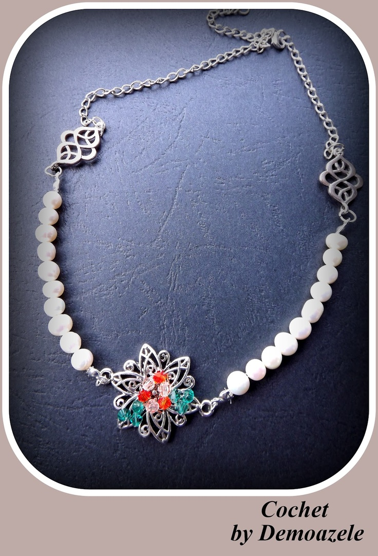 Necklace made with cultured pearls. Tibetan silver flower is accessorized with crystals in various shades.