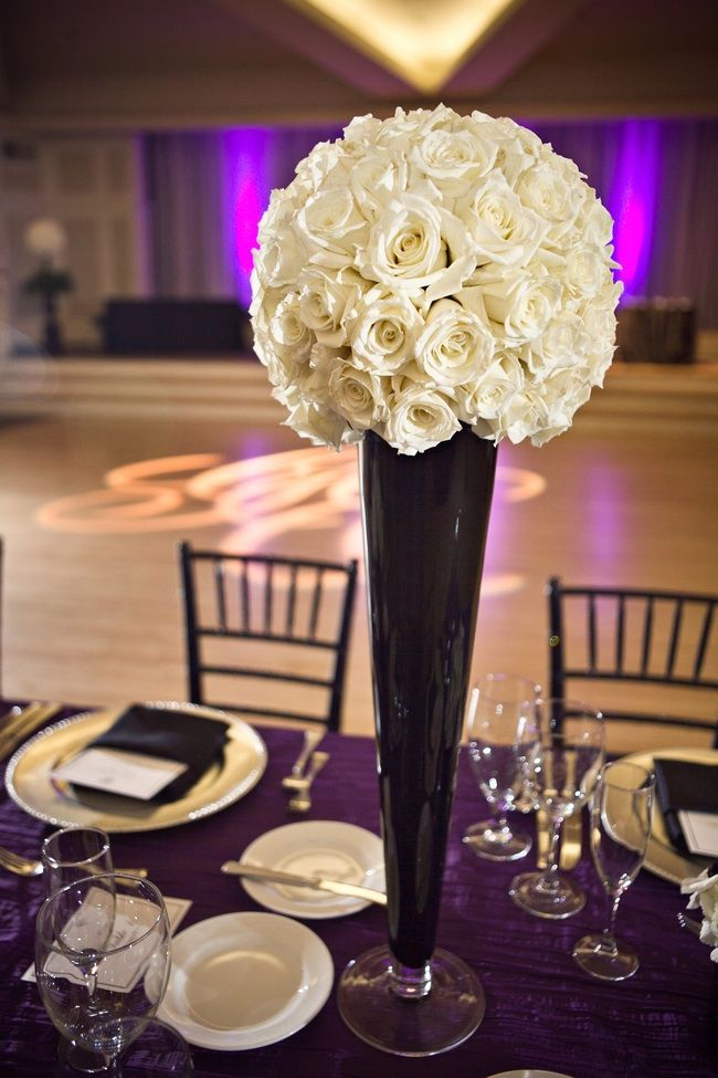 Ivory rose flower ball atop chic black vase for wedding