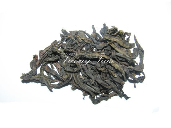 Tie Luo Han is one of the Famous Four Wuyi Rock Teas and also believed to be the earliest Wu Yi tea; with history records dating back to Song Dynasty. The tea bush was first found in a cave (Gui Dong or Ghost Cave) in Hui Yuan Yan, one of the ninety-nine cliffs of Mount Wu Yi.