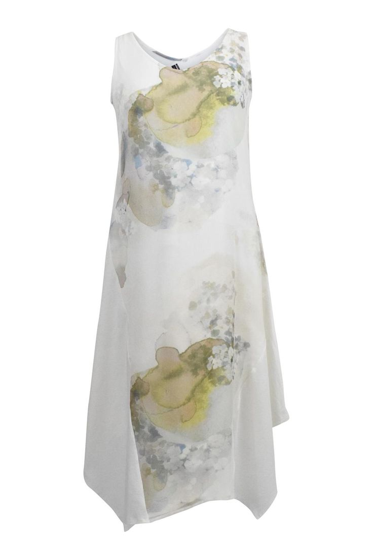 Sheer, printed georgette ushers in the softer side of spring with a delightful, romantic floral print. Flush with easy neutrals and quiet spring colors, this dress is artfully paneled with our soft, organic cotton stretch jersey. Perfect for a summer wedding, garden party, vacation, or a walk on the beach!   Allure Flora Dress by Stella Carakasi. Clothing - Dresses Canada