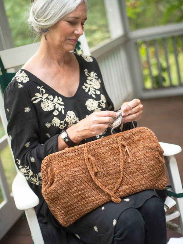 Inspired by old-fashioned medicine bags, this wide-based bag features a tubular frame that will stay open, making it a great choice for carrying your knitting or crochet project.