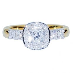 TYYNE - CUSHION SHAPE DIAMOND HALO RING An eye cathing engagement ring was created by encircling a striking cushion cut diamond with a row of matching hand set diamonds. Claw set diamonds are rich gleaming yellow gold finish this romantic piece.