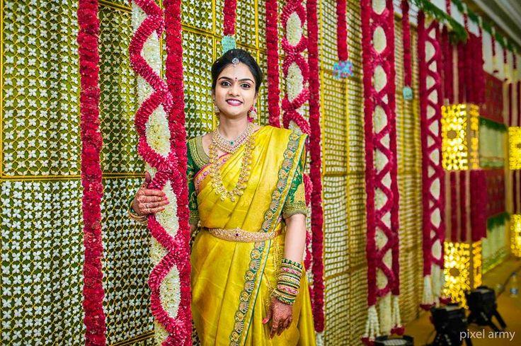 South Indian bride. Gold Indian bridal jewelry.Temple jewelry. Jhumkis. Yellow silk kanchipuram sari.Braid with fresh flowers. Tamil bride. Telugu bride. Kannada bride. Hindu bride. Malayalee bride.Kerala bride.South Indian wedding