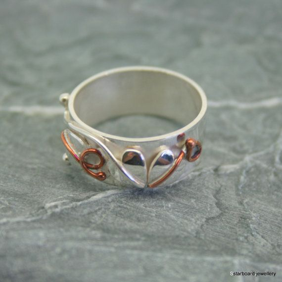 Handmade sterling silver heart and copper by starboardjewellery