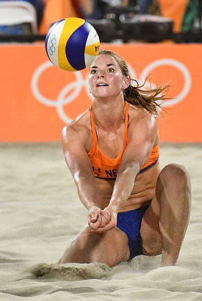 #RIO2016 Jantine van der Vlist of the Netherlands plays a shot during the women's beach volleyball qualifying match between Germany and the Netherlands at the...