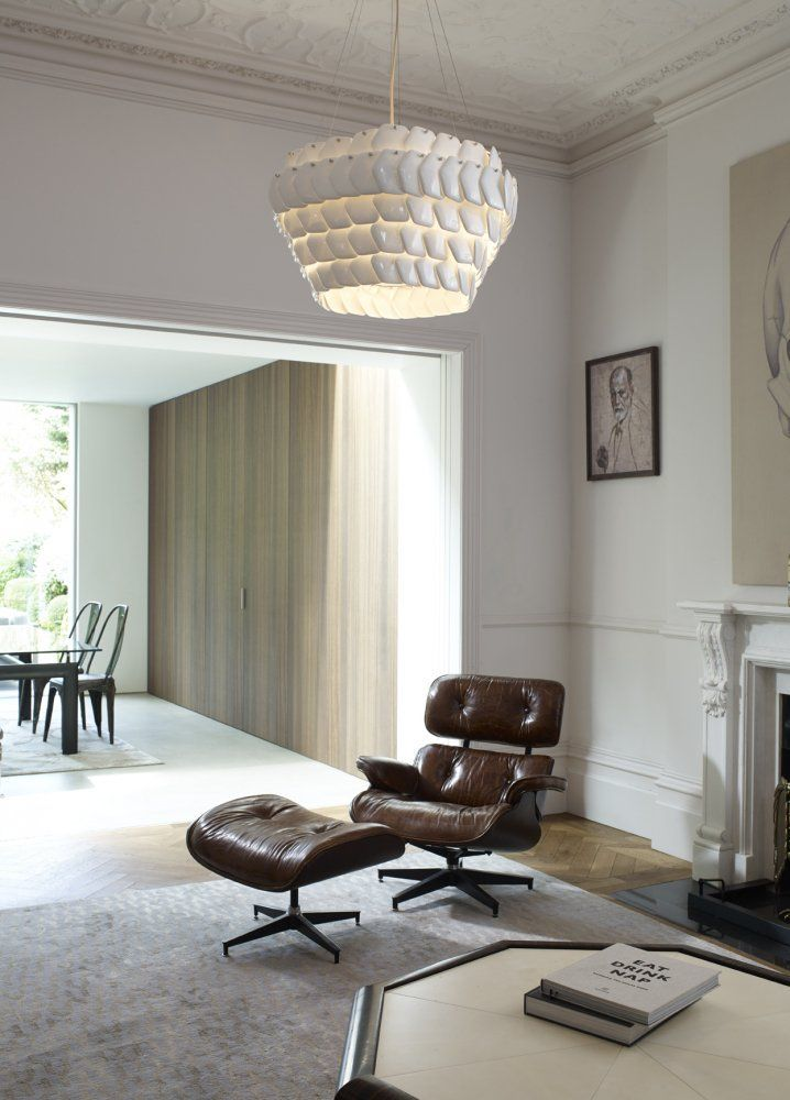 The Cranton Hexagonal bone china pendant light sits comfortably amongst design classics such as this Eames lounger in this mid-century styled home #originalbtc #light #lighting #bonechina #interior #interiordesign #design #designclassics #eames #décor #decoration #mid-century #britishdesign #britishmade #madeinbritain #handmade