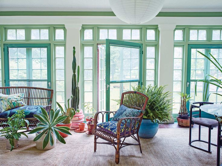 """The paint colors are appropriate to 1918, when the house went up. """"Apparently Charles Lindbergh once landed his plane in our meadow,"""" Findlay says. """"And before the house was here, the land was home to a small abbey."""" The ceramic-coil cactus pot was made by an artist friend, Misha Kahn. The rattan furniture came from an estate sale nearby."""
