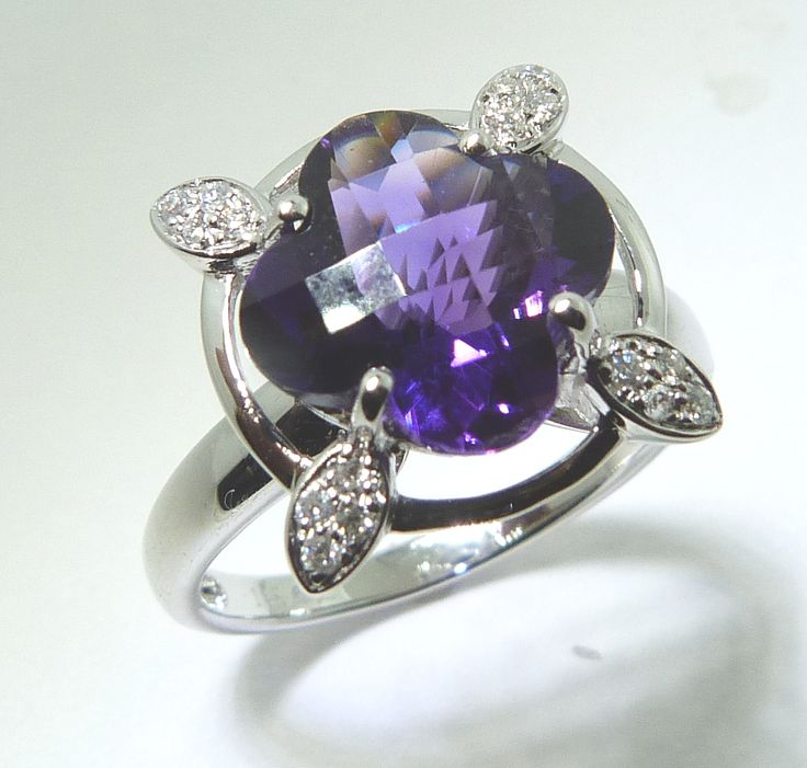 Flowery designs are in style right now and with this great purple amethyst, you cannot go wrong! www.troyshoppejewellers.com