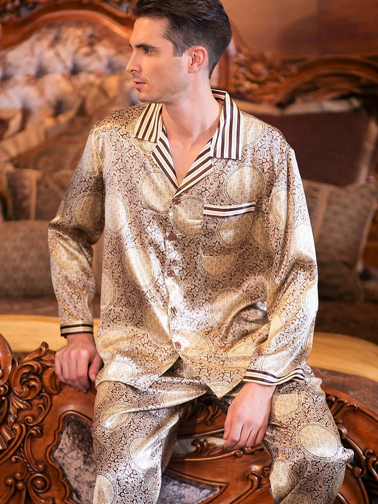 Impeccably designed pure silk pajamas for men feature contrast stripe pattern at neckline, cuffs, chest pocket, and hem of pants.