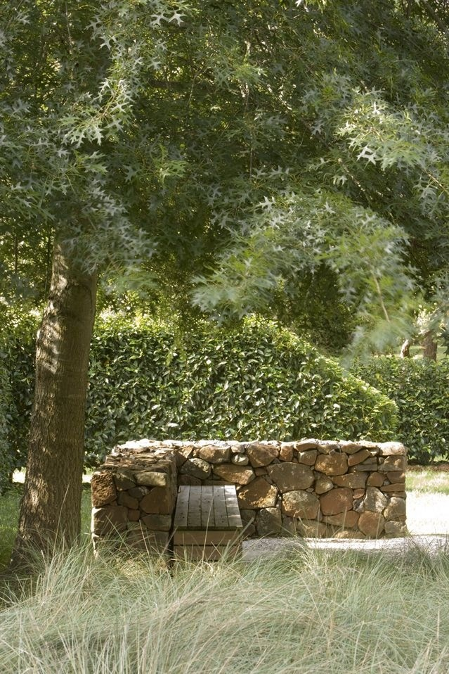 Angled hedge and dry stone wall