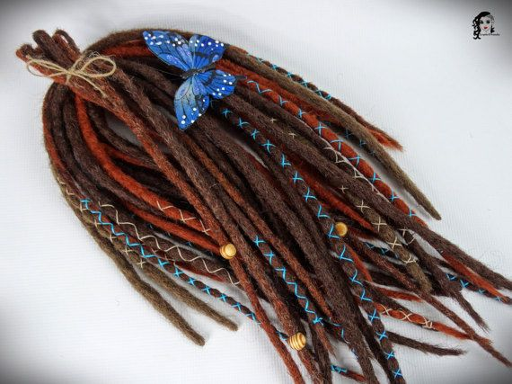 Full Set Crochet Synthetic Dreadlocks Autumn Song 25 DE and SE  Type: Single Ended, Double Ended, crosses Material: Synthetic Hair (100% kanekalon), thread, wood beads, natural twine Method: Crochet, handmade Pieces in set: 25 (5 se, and 20 de) Lenght: 14-20inch (35-55cm) Thickness: 0.79-1.18 inch (2-3cm) Color: brown, light brown, terra, mix terra (blue thread, natural beige twine, natural beige/brown wood beads)   Synthetic crochet dreadlocks have many advantages:  * Light – does not ...