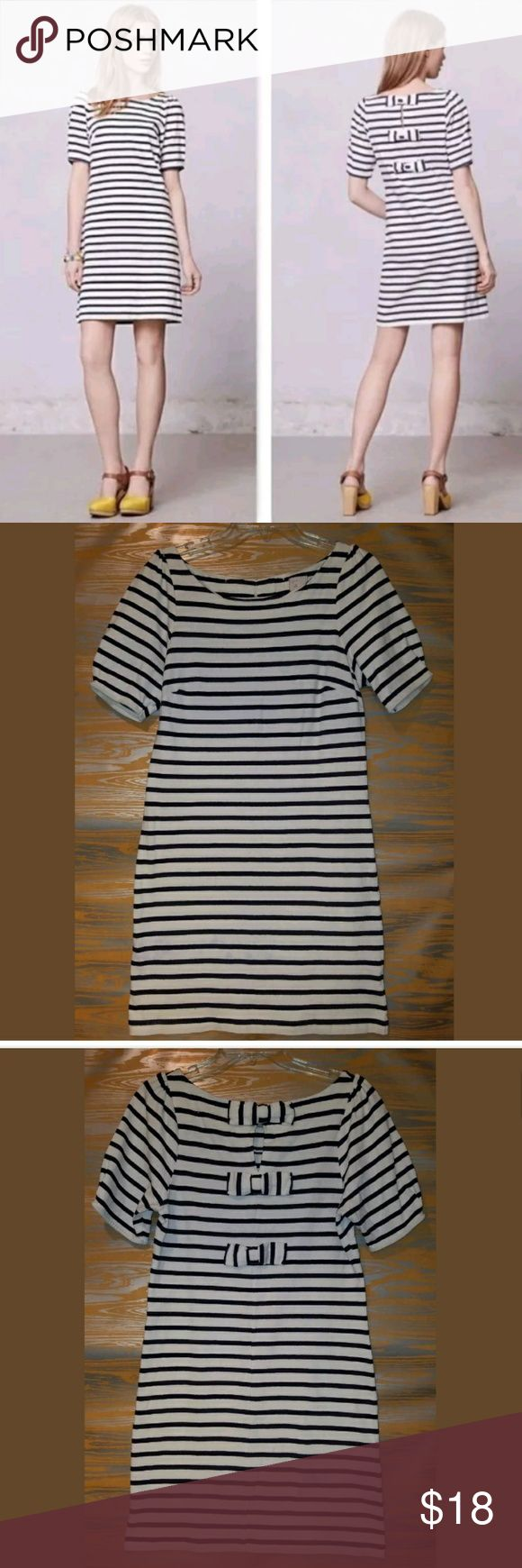 "POSTMARK nautical THREE BOW short slv stripe dress approximate measurements: pit to pit"" 18 - neck to hem 34.5  100% cotton nautical dress  short puff shoulder sleeves  Three bows down the back  Navy blue and white stripes rated good preowned condition some faint spots near the hem  can shorten length or try soaking/washing in oxy-clean Anthropologie Dresses Mini"