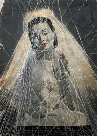 Embroidery over vintage photographs by Hinke Schreuders