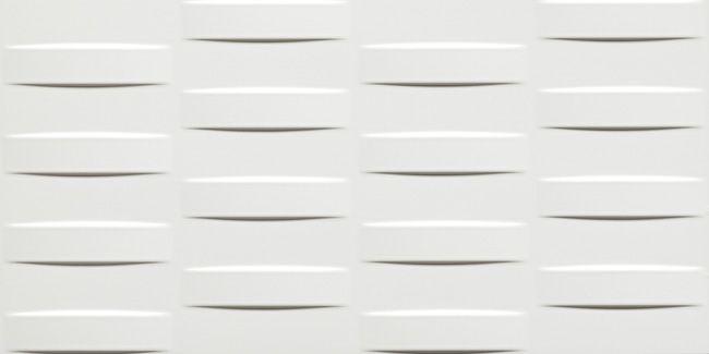 Superfici tridimensionali uniscono uno straordinario impatto decorativo ai vantaggi del miglior rivestimento ceramico in pasta bianca. Un vibrante effetto scultoreo veste di design e funzionalità pareti che diventano protagoniste di aree dedicate al benessere, spazi dell'accoglienza, luoghi dell'ospitalità e del consumo.