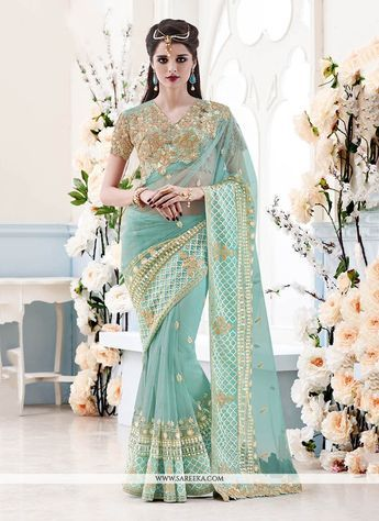 Precise splendor can come out as a results of the dressing style and design with this turquoise net classic designer saree. This pretty attire is showing some incredible embroidery done with embroider...