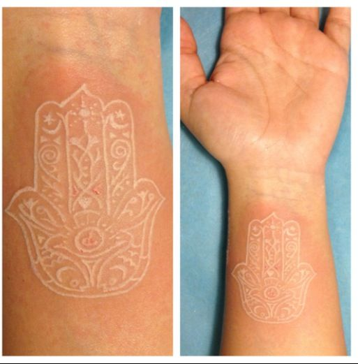 seriously considering getting a white hamsa tattoo