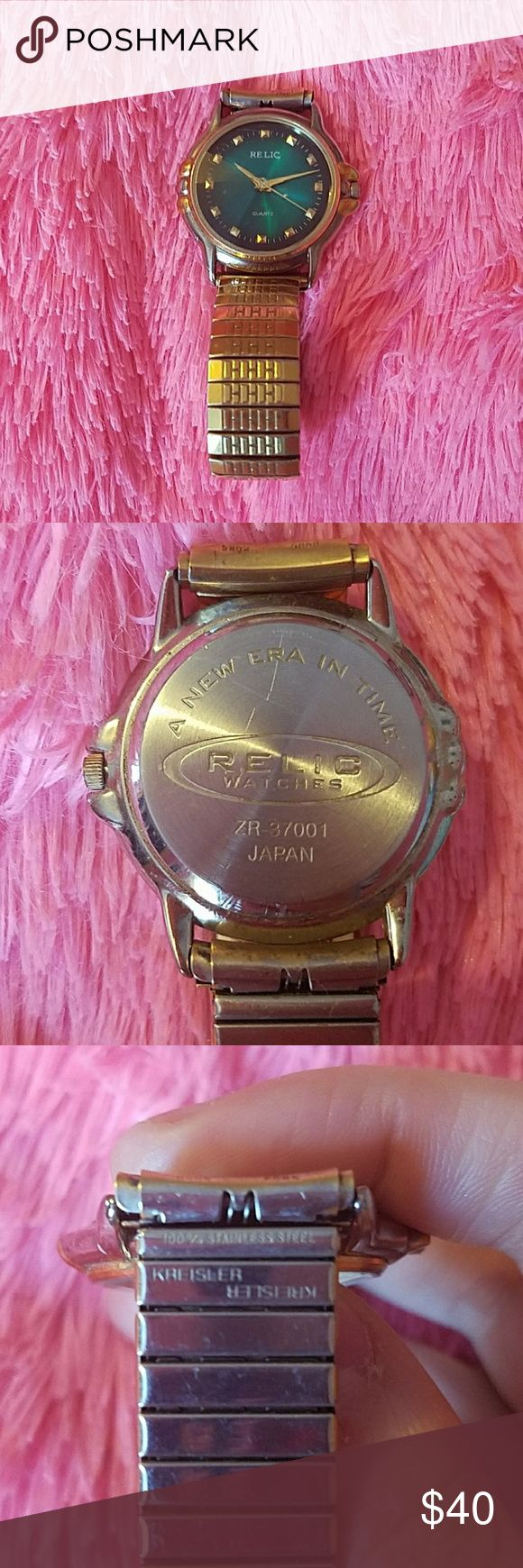 Relic watch Old relic watch Gold colored 100% steel band Watch face is turquoise green quartz  Doesn't run but probably just needs new battery. Can't find price online to go by so make a reasonable offer Relic Accessories Watches