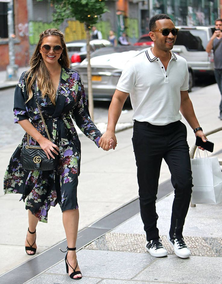 Chrissy Teigen & John Legend from The Big Picture: Today's Hot Photos  Lovebirds! The happy couple hold hands while out shopping in New York City.
