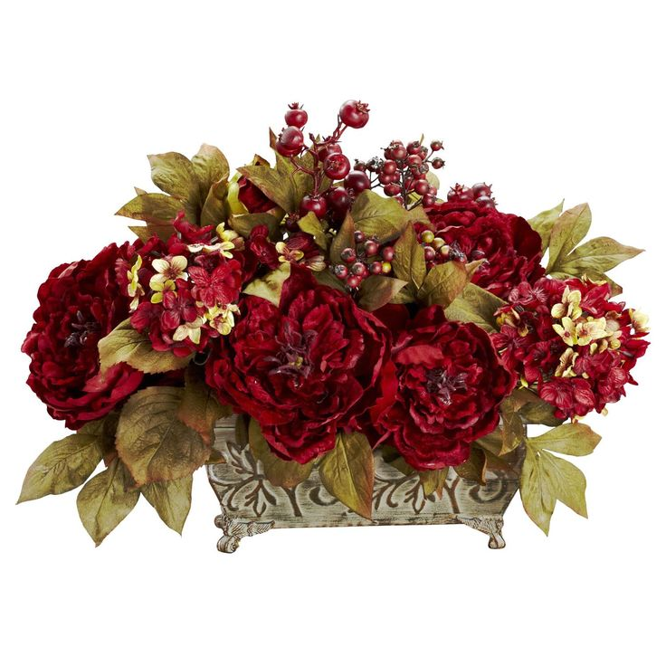 Peony & Hydrangea Silk Arrangement - Provide a warm welcome to the holiday season with this beautiful Peony / Hydrangea arrangement. Bursting blooms of red are surrounded by gold-hued leaves, which provide the perfect backdrop. Lush berries and a stately planter add to the festive look, which will stay fresh year round with nary a drop of water. Makes a great centerpiece. Number of Trunks: NA Number of Flowers: NA Number of Leaves: NA Pot Size: W: 10.75 in, H: 5 in, D: 5.75 in Color: Red…