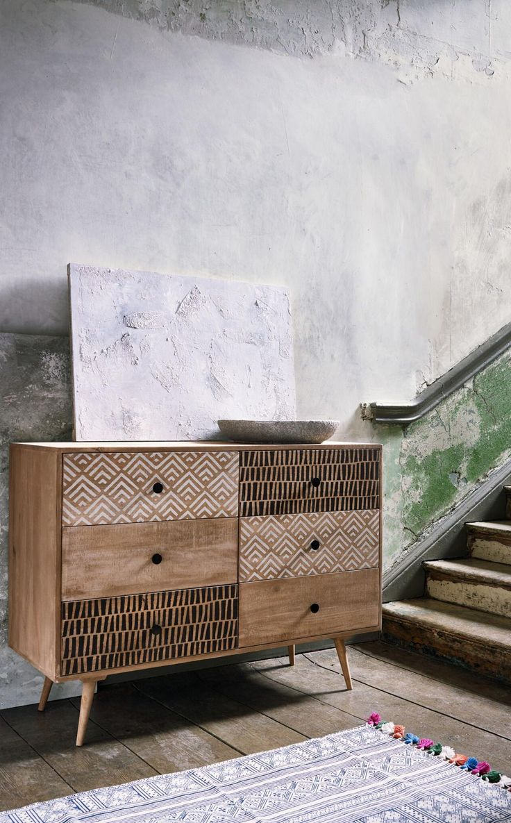 The Karoo chest of drawers. A chest of drawers for people who love the screen-printed look. This mango wood storage unit has a mid-century shape but with ethnic, monochrome prints achieved through the traditional handicraft of screen-printing. Made from mango wood with a subtle Grey Wash finish, it features six generously-sized drawers.