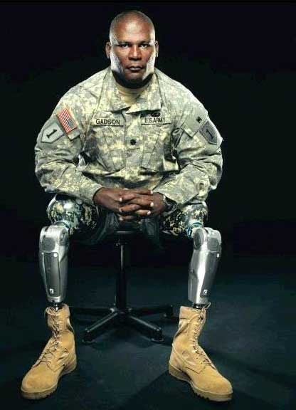 Gred Gadson, a lieutenant colonel w/ the Second Battalion & 32nd Field Artillery, was returning from a memorial service for 2 soldiers when his vehicle passed a roadside bomb on 5/7/07. Gadson remembers the detonation sending his body tumbling through rubble, then medics placing him on a stretcher in a helicopter, his severed feet sitting in his lap. He awakened days later at Walter Reed Army Medical Center in Washington, D.C., his legs amputated above the knees.