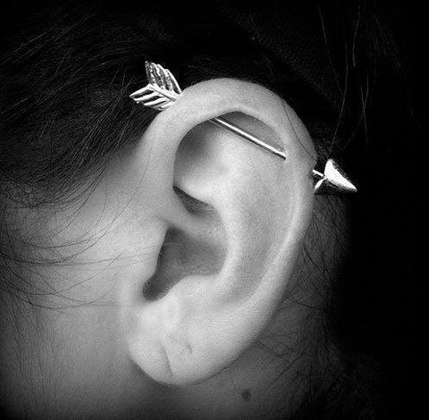 Industrial ear piercing done right… if I was ever gonna get it pierced this is the only way i would do it