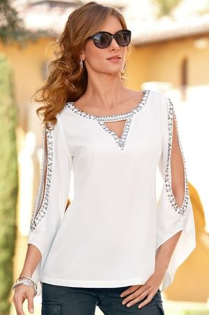 Blouse has long bell sleeves with a front geo cutout, sparkling bead and rhinestone trim.• Polyester.• Imported.• Hand wash.• Effortless.• Sizes 0-18.• Off-white.