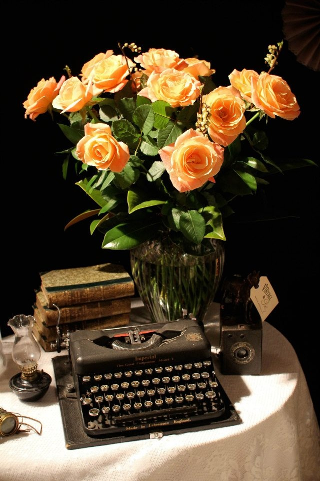 Vintage elegance with beautiful peach roses by Daisy a Day.