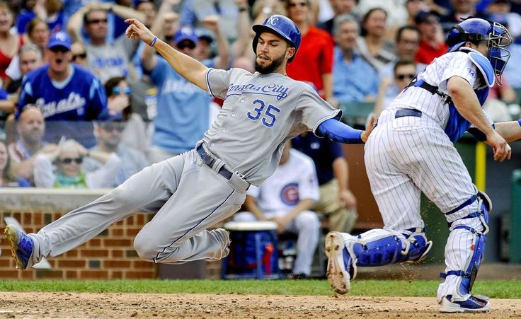 Slide on by -        Kansas City Royals first baseman Eric Hosmer scores during the eighth inning against the Chicago Cubs May 29 in Chicago. The Royals won 8-4.  -   © Matt Marton/USA TODAY Sports