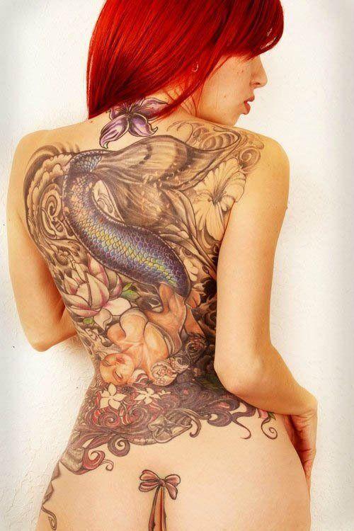 A beautiful back piece of a mermaid kicking back and relaxing. #InkedMagazine #mermaid #tattoo #tattoos #Inked #Ink #art #back