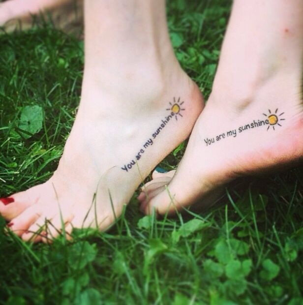 Matching You are my sunshine tattoo with my mom