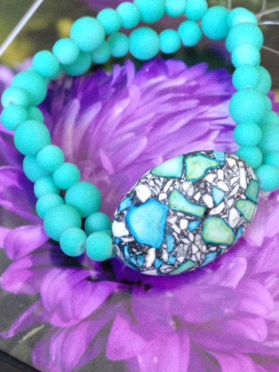 Turquoise beaded stretch bracelet.