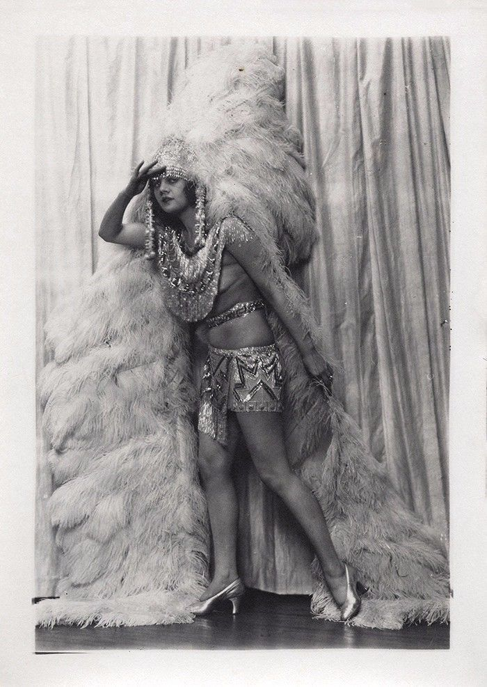 """Charles Sheldon :: Unseen portrait is of Ziegfeld Follies girl and silent film actress Mary Nolan. A leggy jazz-age portrait of the tragic star taken when she was the reigning wild child of showgirls who danced for the Ziegfeld Follies under the colorful nom de plume of Imogene """"Bubbles"""" Wilson. Here we see her posed onstage in full costume for likely a big production number, adorned in a stylized Indian princess headdress with ostrich feathers and a revealing outfit, 1920's"""
