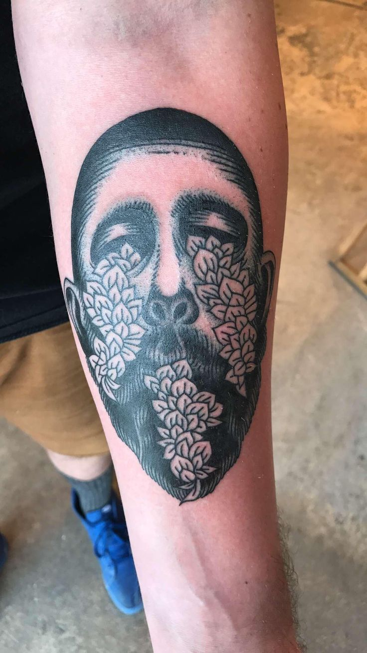 Some people see Kyrie Irving in my tattoo anyone else see it? Its actually based off album artwork by William Schaff