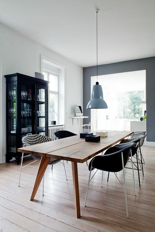 Clean simple timbre dining table. Thin and not heavy looking to give Interior breathing space.