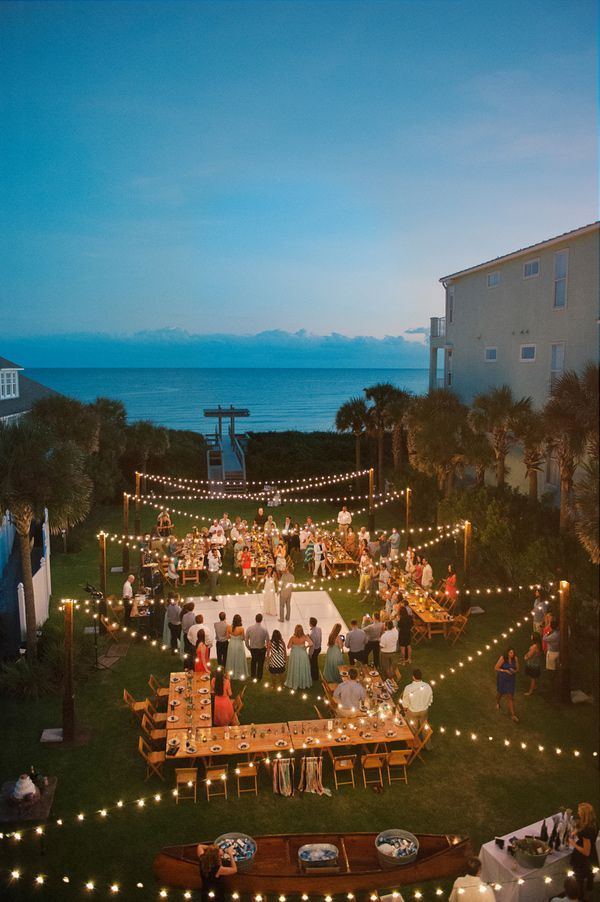 Outdoor wedding reception with the prettiest bistro lights